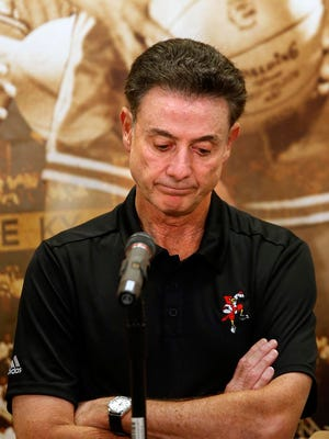 Rick Pitino expresses his disappointment at Friday's news conference.