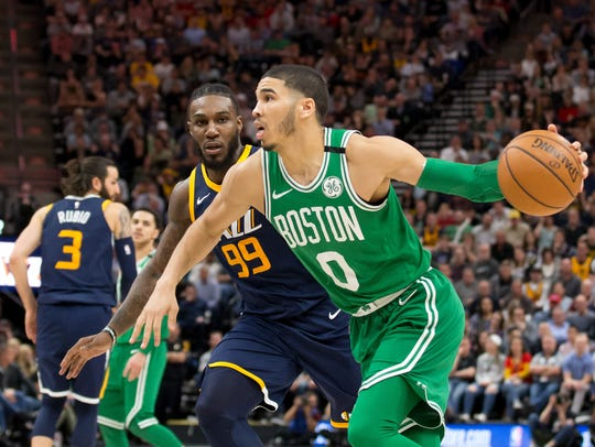 Boston Celtics forward Jayson Tatum (0) dribbles the