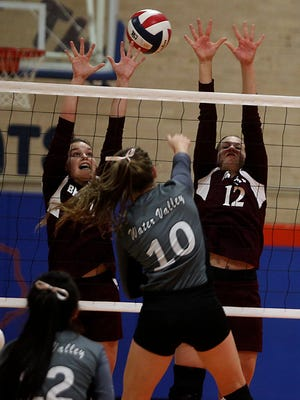 Bronte Longhorns Brittany Bedford (left) and Emily Whitehurst jump to block the ball