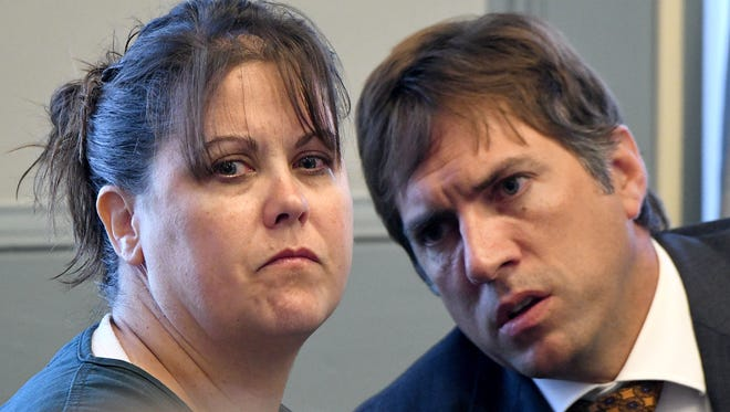 Kim Siracuse is pictured with defense attorney James Mayer III during an earlier hearing.