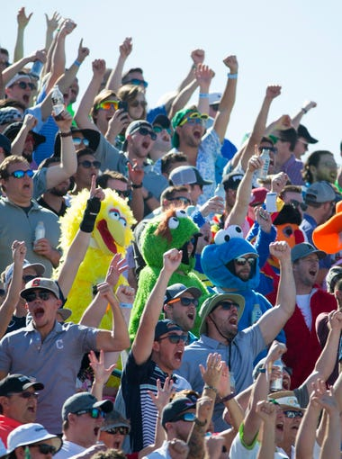 Golf fans cheers on the 16th hole during the third round of the 2018 Waste Management Phoenix Open at TPC in Scottsdale on February 3, 2018.