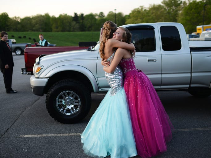 Miranda Odell, 17, and Carlie Shope, 16, hug after arriving at Deerpark on the Biltmore Estate for Enka High School's prom Saturday night. 5/3/14- Erin Brethauer (ebrethau@citizen-times.com)
