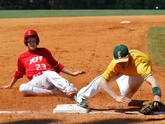 Floyd Central High School's Trey Fulton (7) makes the out at third base on Jeffersonville High School's Jordan Thomas (23) in the  2014 IHSAA Baseball Sectional at Mount Tabor Field in New Albany, Indiana, May 31, 2014.