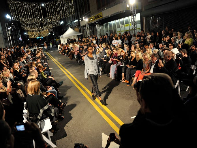 A model walks the runway during a fashion show on 5th Avenue in downtown Nashville, Tenn., Friday, April 4, 2014.