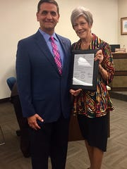 Ann Vaughan being awarded a resolution by Precinct 4 County Commissioner Brent Chesney at the Nueces County Commissioner's Court meeting Oct. 19.