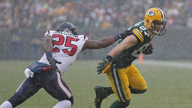 Packers wide receiver Jordy Nelson cuts around Houston Texans cornerback Kareem Jackson after catching a pass on Sunday.