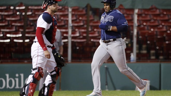Yandy Diaz scores one of Tampa Bay's runs during Monday night's 8-7 victory over the inept Red Sox.
