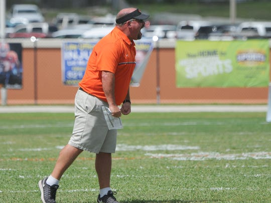 Cocoa football head coach John Wilkinson yells out to the team an early season game in Cocoa.