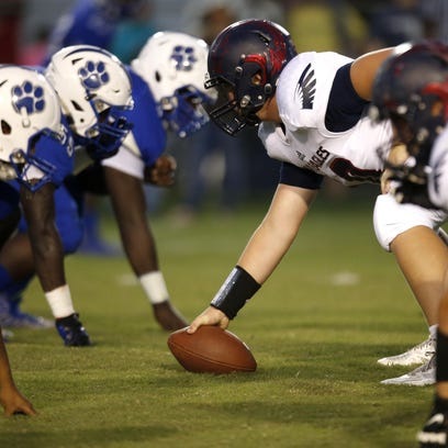 Godby's defensive line and Wakulla's offensive line