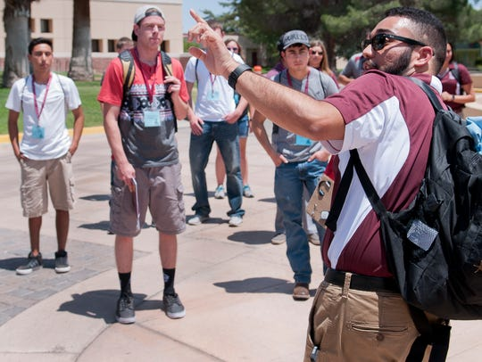 NMSU orientation leader Charles Trujillo points out