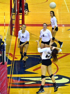 Fairview High Lady Jackets demonstrate teamwork on the volleyball court.