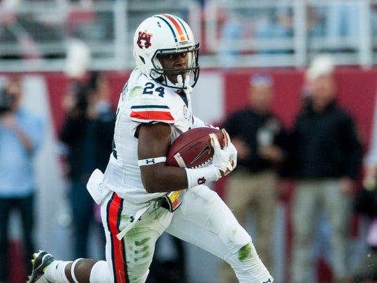 Auburn defensive back Daniel Thomas (24) returns an interception against Alabama during the Iron Bowl at Bryant Denny Stadium in Tuscaloosa, Ala. on Saturday November 26, 2016. (Mickey Welsh / Montgomery Advertiser)