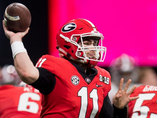 Georgia quarterback Jake Fromm (11) throws against Alabama in first half action of the College Football Playoff National Championship Game in the Mercedes Benz Stadium in Atlanta, Ga., on Monday January 8, 2018. (Mickey Welsh / Montgomery Advertiser)