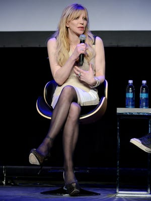 """Courtney Love speaks onstage during the premiere of """"Kurt Cobain: Montage Of Heck"""" during the 2015 Tribeca Film Festival at Spring Studio on April 19, 2015, in New York."""