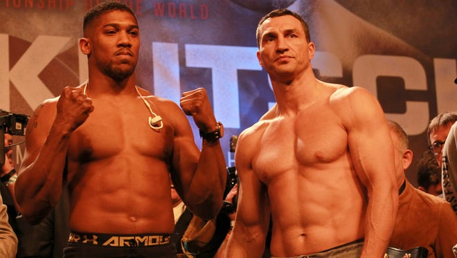 Britain's Anthony Joshua, left, and Wladimir Klitschko  pose during the weigh-in Friday.