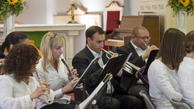 Salem native Michael Thompson, center, plays trumpet with the Chamber Ensemble of the Symphony Orchestra of Northern Virginia.