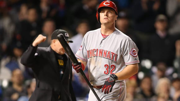 Reds right fielder Jay Bruce reacts after striking