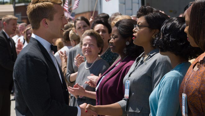 "Katherine G. Johnson (Taraji P. Henson), flanked by fellow mathematicians Dorothy Vaughan (Octavia Spencer) and Mary Jackson (Janelle Monáe), meet the man they helped send into orbit, John Glenn (Glen Powell), in ""Hidden Figures."""