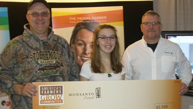 Local farmer Jeff Luebke, left, and America's Farmers Grow Communities have made a $2,500 donation to the Winnebago County 4-H to help the organization cover costs associated with sending students to national and state competitions. From left: Luebke; Ashlynn Numrich, Winnebago County 4-H officer; and Greg Guderyon, channel district sales manager.
