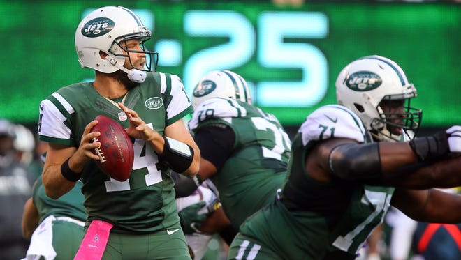 New York Jets quarterback Ryan Fitzpatrick (14) looks to pass the ball  during the second half at MetLife Stadium. The Jets defeated the Ravens 24-16.