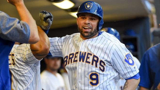 Brewers catcher Manny Pina celebrates in the dugout after hitting a two-run homer in the second inning.