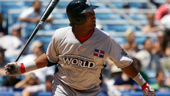 NEW YORK - JULY 13:  Juan Francisco #34 of the Cincinnati Reds and playing for the World Futures Team hits a single against the United States Olympic Team during the 2008 XM All-Star Futures Game at Yankee Stadium on July 13, 2008 in the Bronx borough of New York City.