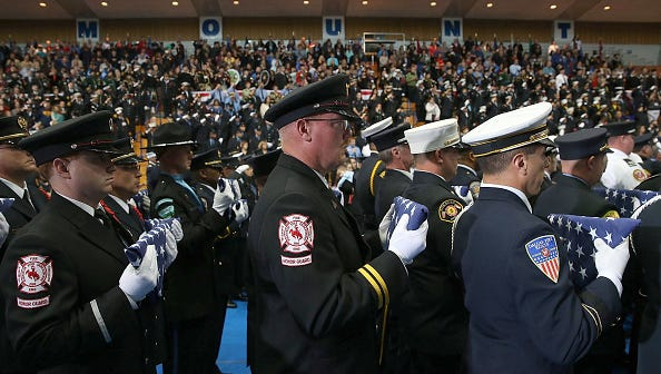 EMMITSBURG, MD - OCTOBER 04: Firefighters carry folded flags during the National Fallen Firefighters Foundation Memorial Service October 4, 2015 in Emmitsburg, Maryland. President Obama honored 84 firefighters that were killed in the line of duty last year and an additional three firefighters killed in previous years. There have been 65 firefighter fatalities reported in 2015, according to the U.S. Fire Administration.  (Photo by Mark Wilson/Getty Images)