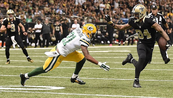 NEW ORLEANS, LA - OCTOBER 26:  Kenny Stills #84 of the New Orleans Saints runs the ball as Ha Ha Clinton-Dix #21 of the Green Bay Packers defends during the first quarter at Mercedes-Benz Superdome on October 26, 2014 in New Orleans, Louisiana.  (Photo by Stacy Revere/Getty Images)