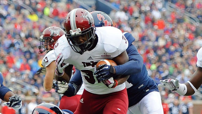 Brandon Burks (32) is back to give Troy a dynamic running back tandem again in 2014.