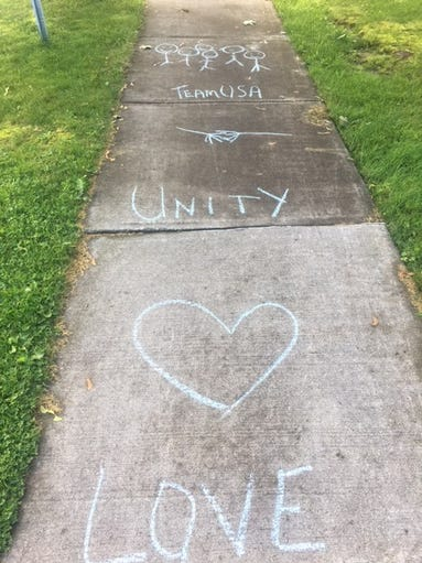 Messages of love on sidewalks in Honeoye Falls.