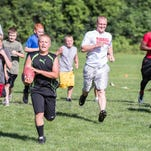 Marshall 5th grader Owen Valintine does agility drills at youth football camp in Marshall.