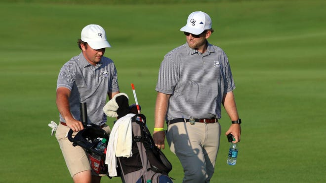 Steven Fisk, left, and Georgia Southern coach Carter Collins make their way to the 18th green at the 2019 NCAA Championship.