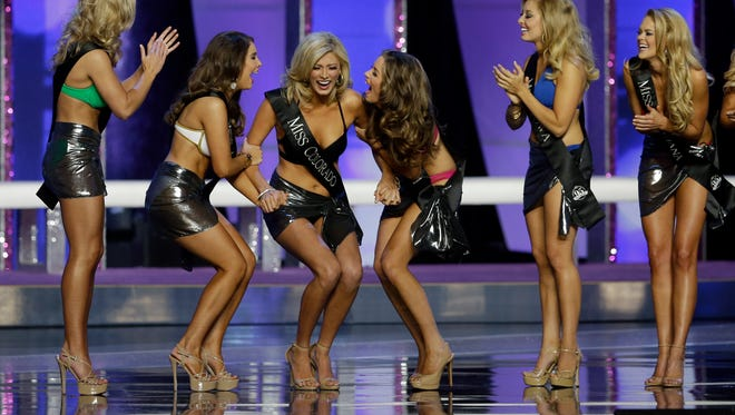 Miss Colorado Kelley Johnson is congratulated as she moves on as she competes in the 2016 Miss America pageant, Sunday, Sept. 13, 2015, in Atlantic City, N.J. (AP Photo/Mel Evans)