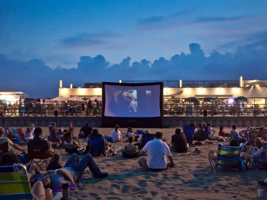 Ditch the dark theater and take a seat on the sand (or in the water) for this summer beach experience.