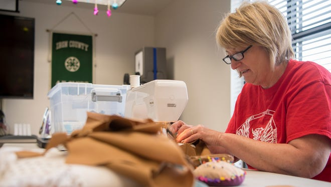 Cheryl Williams sews a 'procedure doll' for children at the Utah State University extension office Monday, April 2, 2018. The dolls will go to hospitals where doctors can use them to explain procedures to children.