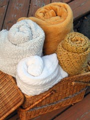 Set out a basket of cozy blankets in case guests get chilly.