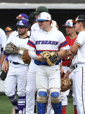 Seniors from the 2020 Federal League baseball teams gather at home plate prior to playing a doubleheader at Jackson on Saturday.  COVID-19 knocked out the spring season, so the games gave the graduates a final game in their school uniforms.