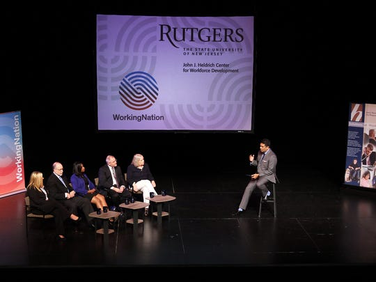PBS NewsHour anchor and correspondent Hari Sreenivasan, r, moderates the WorkingNation and Heldrich Center for Workforce Development Town Hall-style meeting called 'Re-skilling The Mid-Career Workforce held at the Mastrobuono Theater at Rutgers University. August 8, 2017. New Brunswick, NJ