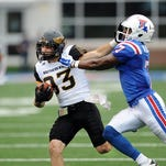 Southern Miss wide receiver Casey Martin, left, runs the ball against Louisiana Tech during an NCAA college football game Saturday, Nov. 28, 2015 in Ruston, La. (Susan Broadbridge/The Hattiesburg American via AP)