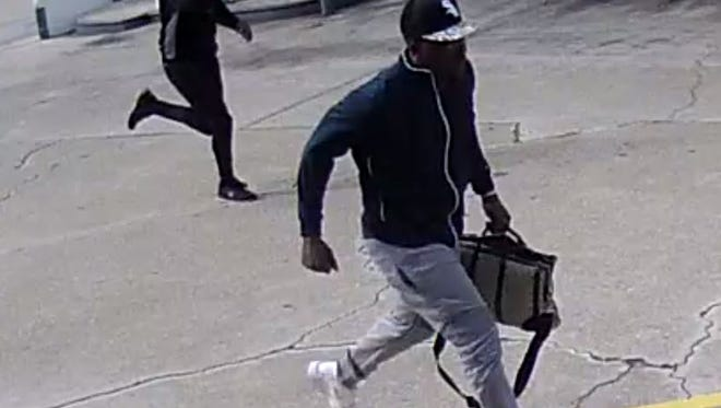 Police are looking for two men who robbed a guest at a Summerlin Road hotel as he was entering his room on Monday.