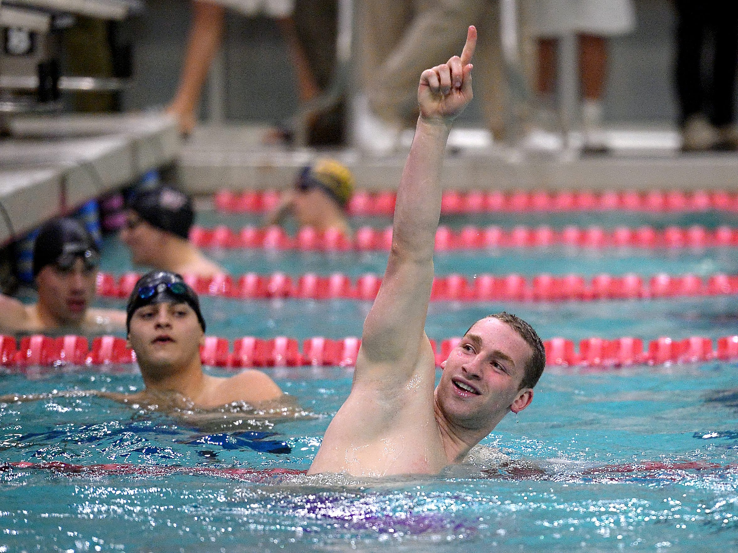 Brighton's Noah Stevens celebrates winning the finals of the 100-yard butterfly.