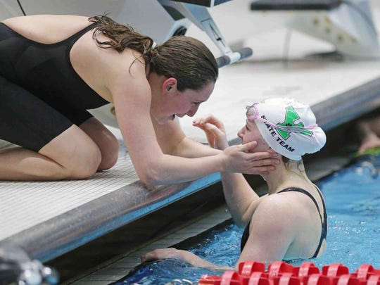 Mari Gray congratulates Yorktown's Emily Weiss after completing the girls 100 yard breaststroke, during the IHSAA girls swimming state finals, held at IUPUI Natatorium, Feb. 11, 2017.