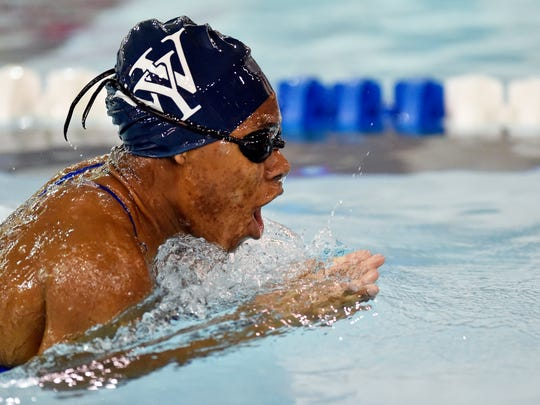 West York's Tesia Thomas swims the girls' 100-yard breaststroke in a YAIAA dual swim meet Thursday, Jan. 11, 2018, at Dover. Dover swept West York, with the girls winning 101-83 and boys winning 90-88. Thomas won the event with a time of 1:16.81.