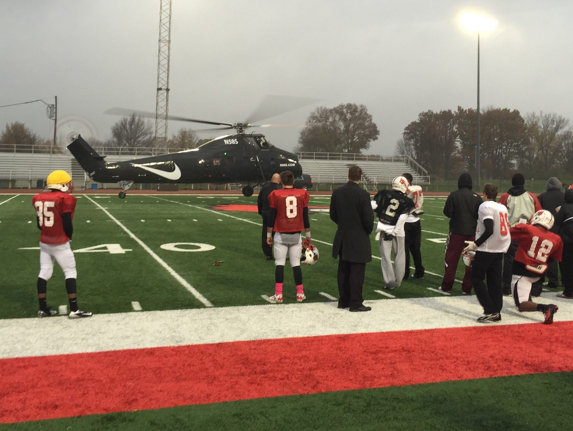 Nike, one of Colerain's corporate sponsors, delivered the Cardinals' cold weather gear by helicopter at practice Nov. 6, 2014.