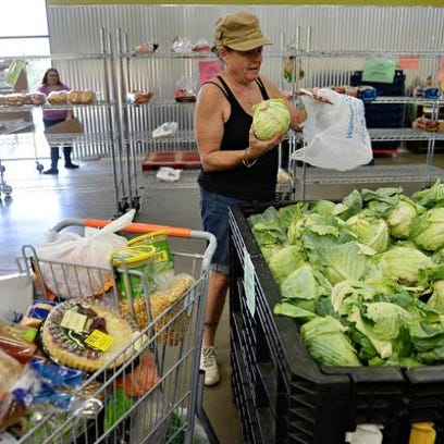 Rita Wilkens-Coon shops the Food Share program at the