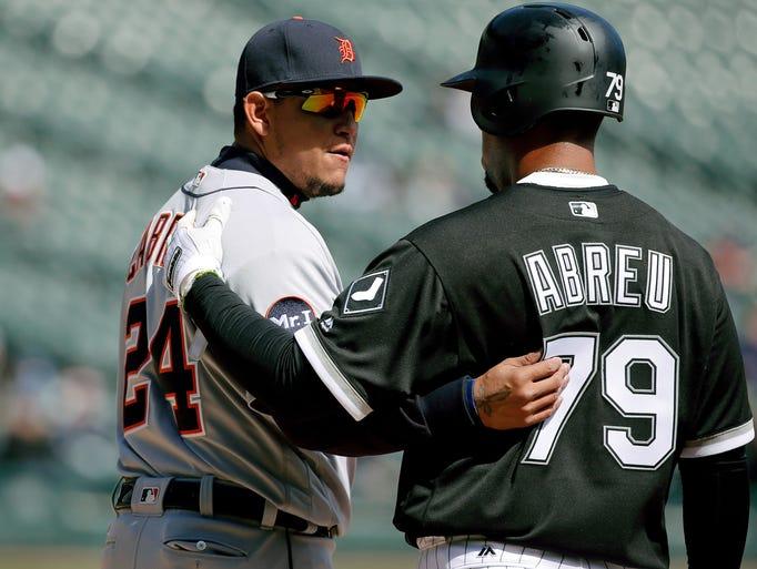 Tigers first baseman Miguel Cabrera chats up Jose Abreu