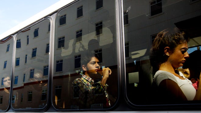 FGCU students take a shuttle bus to the main campus from the South Village residential complex Wednesday. Nearly three-fourths of freshmen live on campus.