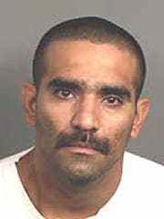 Daniel Valladares was arrested during a drug investigation in Thousand Palms. He had a warrant for his arrest following an attack involving his wife, officials said.