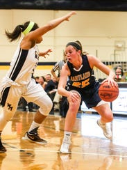 Hartland's Lexey Tobel (25) is a three-time first-team