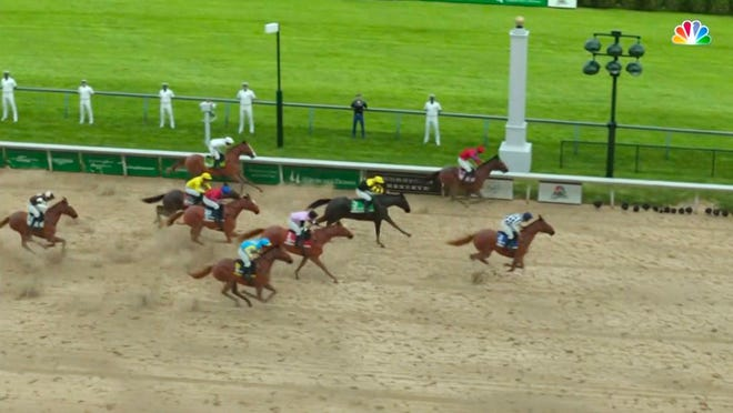 In this image taken from video provided by NBC Sports, Secretariat, right, crosses the finish line to win a computer-simulated version of the Kentucky Derby horse race between the 13 winners of the Triple Crown, Saturday, May 2, 2020, in Louisville, Ky. The race was part of NBC's substitute programming after the Kentucky Derby was postponed by the coronavirus pandemic.